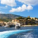 Castle rock and Marina Corta in Lipari seen from the sea, Aeolian Islands, Italy
